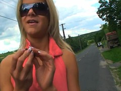 Golden-haired in sunglasses pumped on roadside