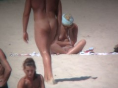 2 older battalion flashing their saggy love muffins and vaginas for a concealed voyeur web camera during the time that tanning on be imparted to murder beach