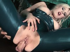 Luscious golden-haired floosie in latex receives taken by 2 randy chaps in a three-some