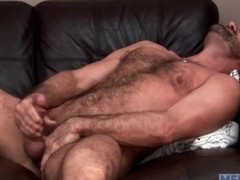 Bear masturbates and toys his anal opening